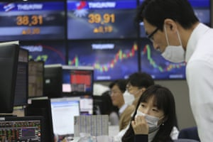 Currency traders at the foreign exchange dealing room of the KEB Hana Bank headquarters in Seoul, South Korea.