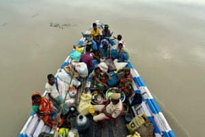 Flood affected villagers are shifted to a relief camp in a small boat in Morigaon district, Assam, India