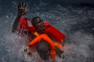 Spot news – stories, third prize  Two men struggle in the water during a rescue in the Mediterranean