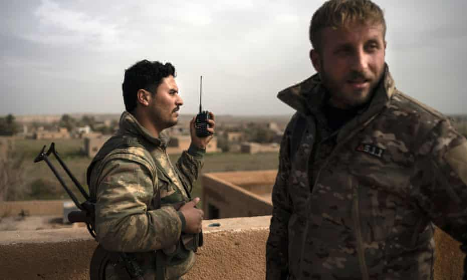US-backed Syrian Democratic Forces fighters take up positions against Isis militants in Baghuz.