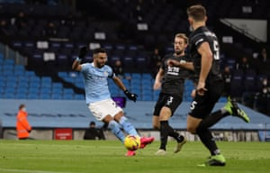Manchester City's Riyad Mahrez curls in the opening goal.