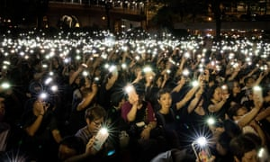 Demonstrators protest against police brutality at the end of a week in which unrest rocked Hong Kong. ,