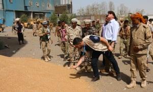 A team from the UN World Food Programme visit mills in Hodeidah, Yemen, on Tuesday.