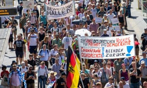 Protesters against coronavirus restrictions march in Berlin on Saturday