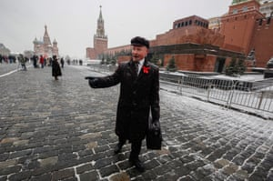 An impersonator of Vladimir Lenin, a founder of the Russian Communist party and father of the Communist revolution, walks in front of Lenin's mausoleum. Lenin, who died in 1924, was placed in the mausoleum despite his wish to be buried near his mother at Volkovo cemetery in St. Petersburg