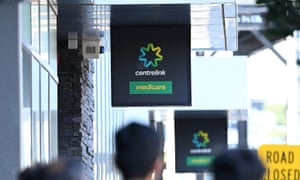 People queue to enter Centrelink on March 24, 2020 in Melbourne, Australia.