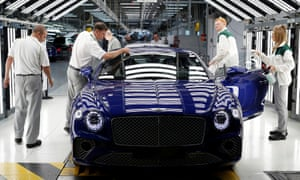 Workers inspect a Bentley Continental GT at the luxury automaker's manufacturing facility in Crewe before the coronavirus lockdowns forced production to cease.