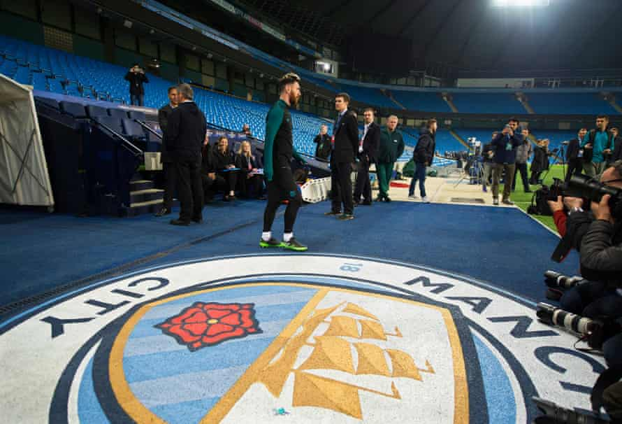 Lionel Messi arrives for his team's training session at the City of Manchester Stadium.