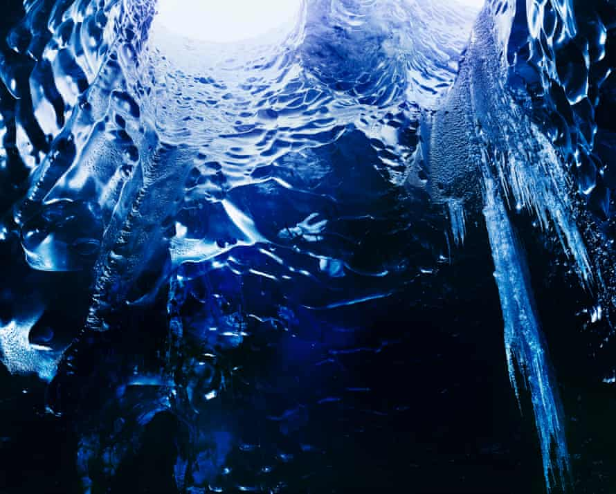 Ice Cave, Vatnajökull, 2014. Conceptual documentary photographer Richard Mosse used a large-format plate-film camera and infrared film to photograph the ice cave under the Vatnajökull glacier in Iceland. Glacier caves usually form when air enters where water flows underneath the ice, the warm air slowly creates melting and forms a cave from beneath. The dynamic process is becoming more unpredictable as the weather changes and cave access may become impossible in the future.