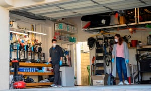 A husband and wife making protective visors with 3D printers in their home garage in Calabasas, California.