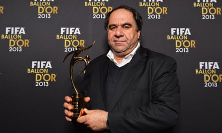 Keramuudin Karim poses with the Fifa fair play award after the 2013 Ballon d'Or gala, held in January 2014