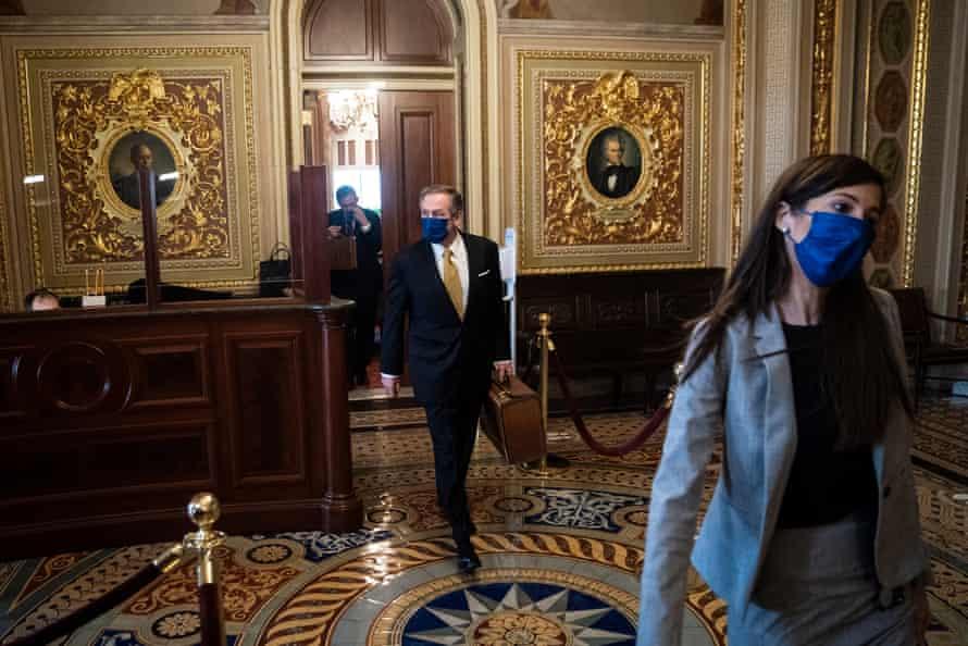 Michael van der Veen, lawyer for Donald Trump, walks to the Senate floor on Friday.