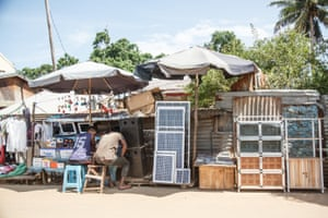 Stalls with solar panels that are sold on the main road of Sambava, cashing in on the wealth of the vanilla trade