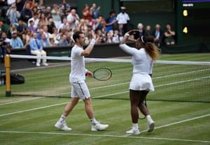 Andy Murray and Serena Williams celebrate their victory.