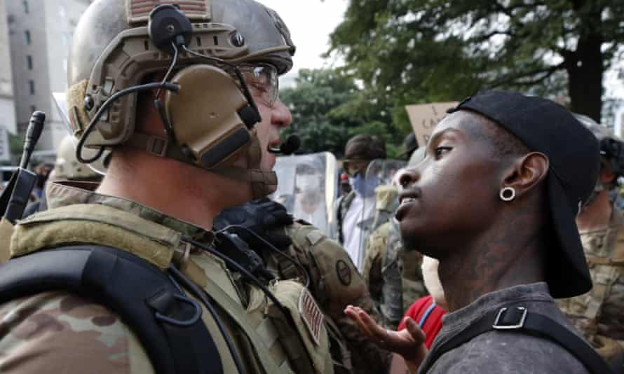 A National Guard solider and a demonstrator in Washington last week.