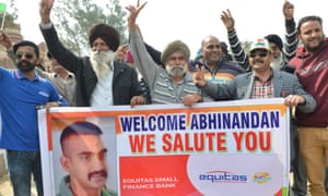 Crowds near the India-Pakistan border wait for the return of an Indian pilot shot down over Kashmir