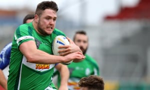 Luke Ambler holds the ball for Ireland in a match against Scotland