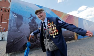 A veteran shows off his medals in Moscow