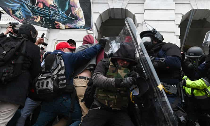 Riot police push back a crowd of supporters of US President Donald Trump after they stormed the Capitol building in Washington, DC, 6 January 2021.