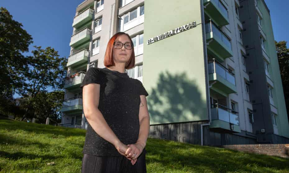 Hayley Myers outside her block of flats in south London.