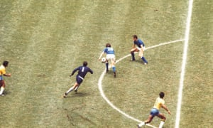 Roberto Boninsegna, centre, hunts down the loose ball after the Brazil goalkeeper Felix's challenge, before equalising for Italy.