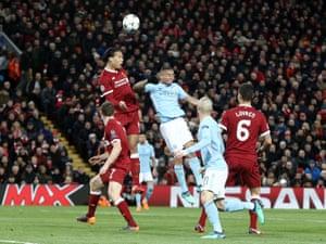 Liverpool's Virgil van Dijk out jumps Manchester City's Gabriel Jesus.