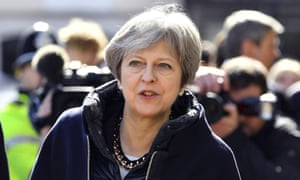 Theresa May views the area where Sergei Skripal and his daughter Yulia were found critically ill in Salisbury, England.