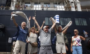 Excited passengers disembark from the MS Westerdam cruise ship after being stranded for two weeks.