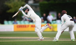 Worcestershire batsman Ed Barnard drives a ball to the boundary.