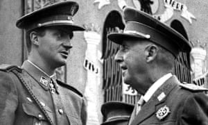 General Francisco Franco, right, talks with then Prince Juan Carlos during a military parade in Madrid, May 29, 1966.