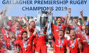 Saracens celebrate victory by lifting the trophy at Twickenham.