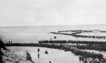 Troops moving forward to the sea near Dunkirk during the evacuation.