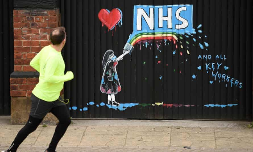 The NHS and key workers are thanked in an artwork on the gates of a closed pub in April.