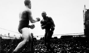 Tommy Burns and Jack Johnson fighting for the heavyweight championship in Sydney