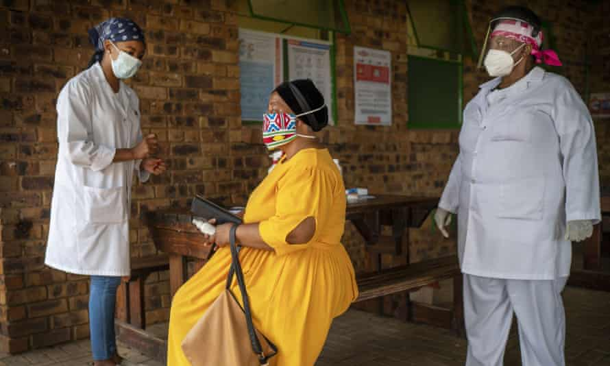 A woman is briefed before taking a Covid-19 test at the Ndlovu clinic in Groblersdal, South Africa.