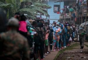 Queue of migrants