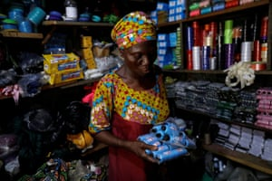 Shopping for threads for her bag-making business at a store in Ilorin
