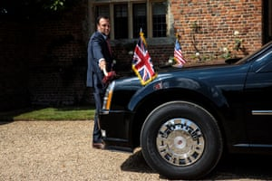 A driver polishes the US presidential car at Chequers
