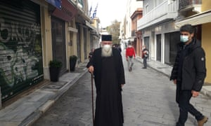Greece's spiritual leader archbishop Ieronymos II taking a stroll in the Plaka district of ancient Athens.