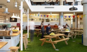 Innocent canteen, wooden tables and grassy floors