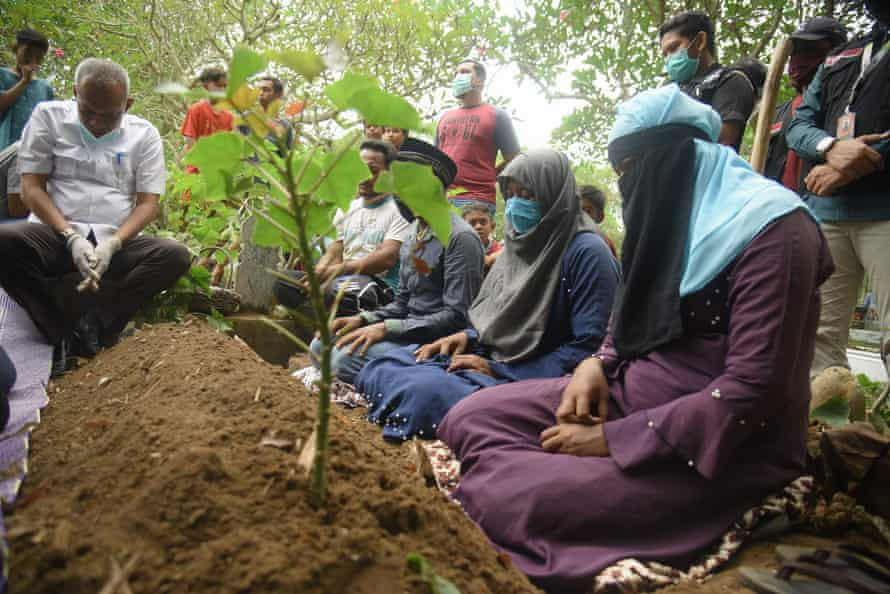 A group of Rohingya migrants gather to bury a 21-year-old woman in Lhokseumawe, Aceh on 9 September 2020,