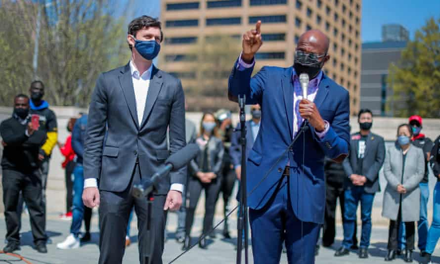 US senators Raphael Warnock, right, and Jon Ossoff participate in a march and rally in downtown Atlanta.