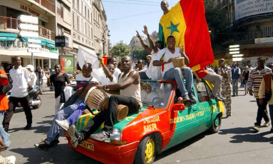 Senegal supporters celebrate in central Marseille after their country's victory over France in the 2002 World Cup's opening game on 31 May