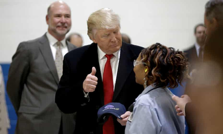 Donald Trump tours the Carrier factory in Indianapolis in December 2016. Trump promised to stop jobs being sent abroad to Mexico but hundreds of workers have since been let go.