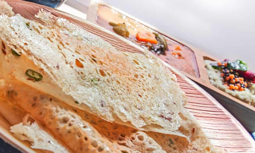 Rava Dosa along with coconut chutney and Sambhar made of Spices and lenthils,
