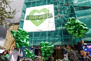 Green balloons outside the Notting Hill Methodist church in tribute to the victims
