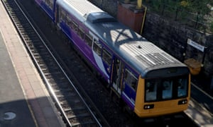 A Northern Pacer train travels through Hunts Cross station in Liverpool.