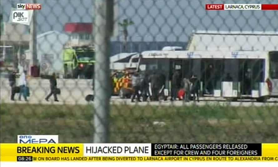 Passengers leave the hijacked plane at Larnaca airport