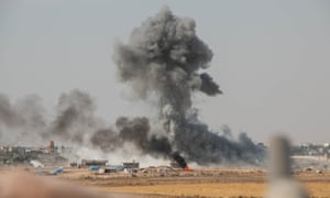 Smoke rises amid bombing of the Kurdish-held city of Ras al-Ayn by Turkish-supporting rebels.