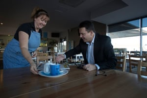 Nick Xenophon has breakfast at a cafe in Whyalla.